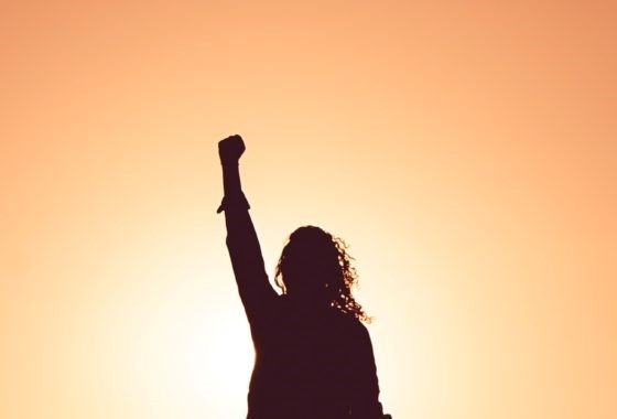Confident lady with fist in the air