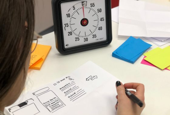 Picture Of Person Working With A Clock On Their Desk