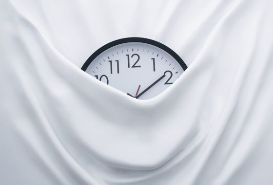 Picture Of A Clock Emerging From Behind A Sheet